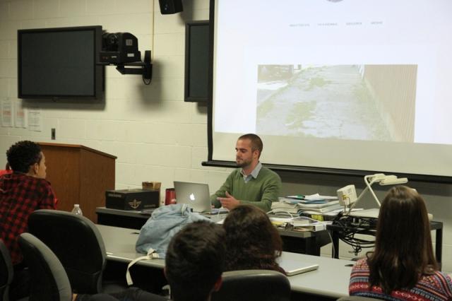 Jakub Rudnik shows students The Chicago Stumbler. (Photo by Brianna Kelly)
