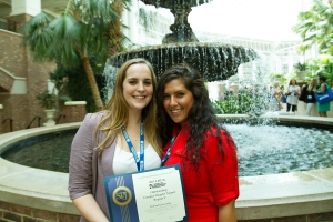 2013-2014 E-board president Brianna Kelly (left) and Secretary/Treasurer Rima Mandwee (right) display the award. (Photo/Mike Reilley)